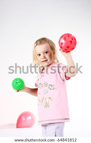 cute baby with balls in studio