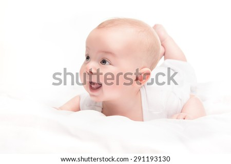Cute baby with beautiful lying in white bed