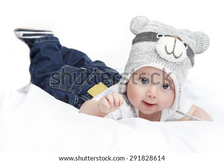 Cute baby with beautiful lying in white bed - stock photo