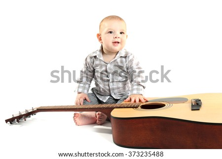 Cute baby with guitar isolated on white background