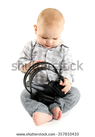 Cute baby with headphones isolated on white background