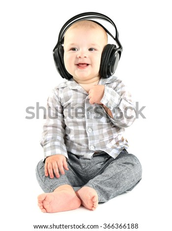Cute baby with headphones isolated on white background - stock photo