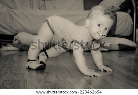 Cute baby with painted mustache standing - black/white filter - stock photo