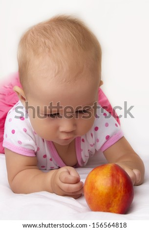 Cute baby with peach