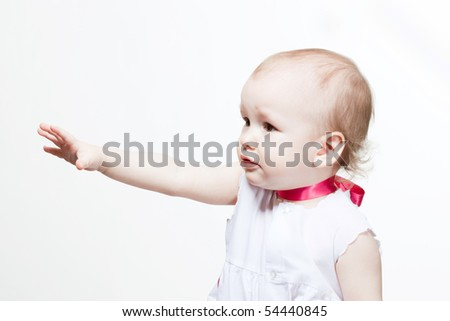 Cute baby with pink silk necklace asking for something
