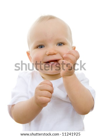 Cute baby with thumb in his mouth and teeth