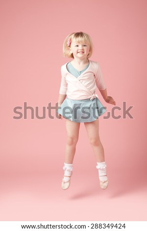 Cute Ballerina jumping for joy - stock photo