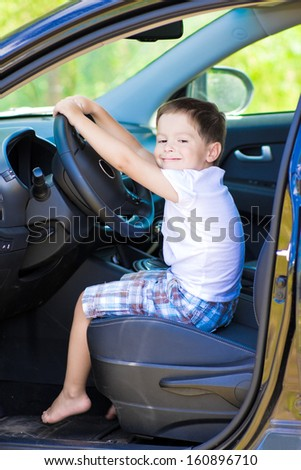 Cute barefoot  driver in car