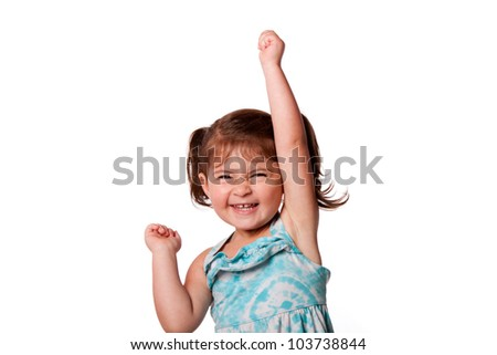 Cute beautiful funny happy little toddler girl celebrating with hand up in air, isolated. - stock photo