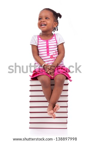Cute black african american little girl seated in a stack of books, isolated on white background - African people - Children - stock photo