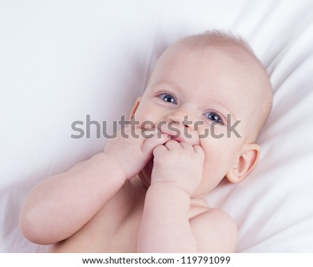 cute blond baby girl laughing
