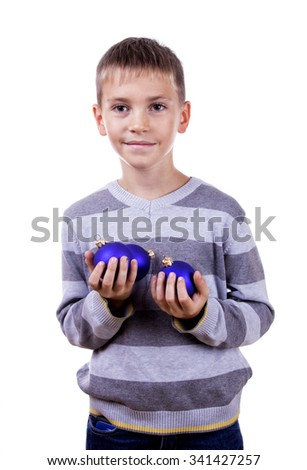 Cute blond boy holding a Christmas toy. Isolated on white background.