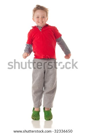 Cute blond boy jumping, isolated on white