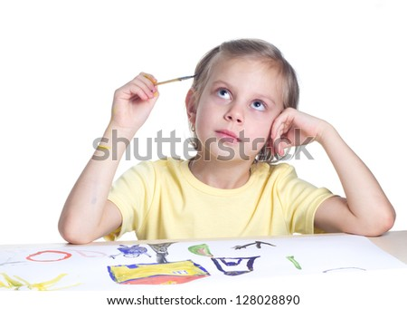 Cute blond girl draws paints on white background