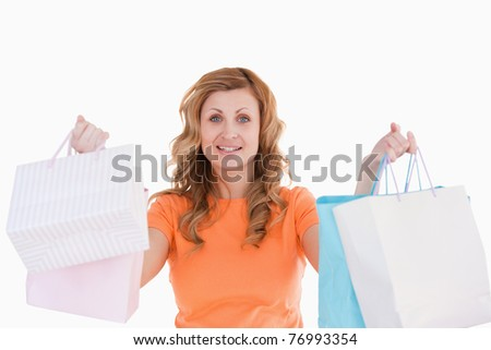 Cute blond-haired woman showing her shopping