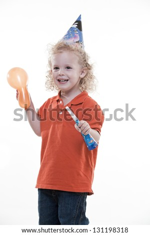 Cute blond jewish toddler boy having fun in party