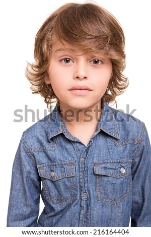 Cute blond kid posing over white background - stock photo