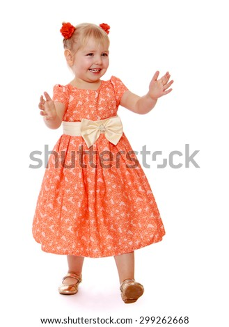 Cute blond little girl in a long summer dress walks forward with his two hands , girl playing with their peers in hide and seek-Isolated on white background - stock photo