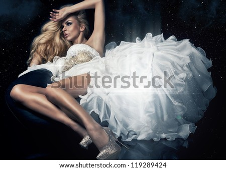 Cute blond woman in gorgeous dress in the stars - stock photo