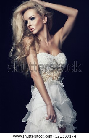 Cute blond woman in white wedding dress - stock photo