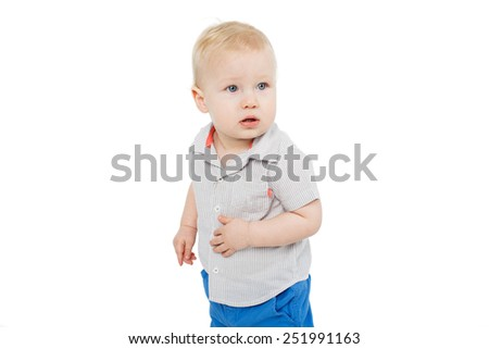 cute blonde blue eyed baby boy standing over white background