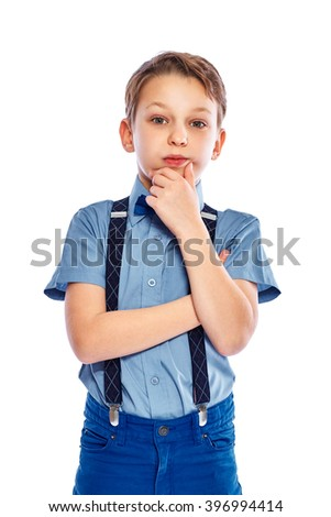 Cute blonde boy in half-length casual style blue jeans posing.  Isolated on white background. - stock photo