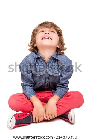 Cute blonde boy posing over white background - stock photo