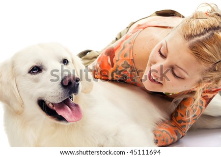 Cute blonde playing with a retriever - stock photo