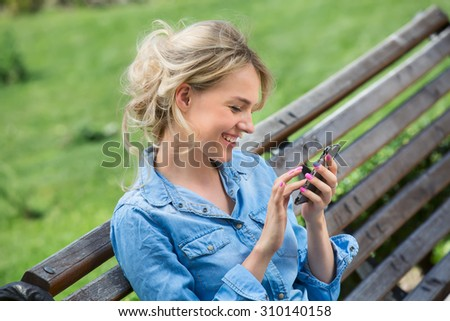 Cute blonde talking on a cell phone. - stock photo