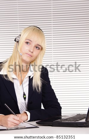 cute blonde worker at table at office