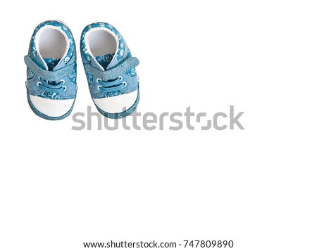 Cute blue baby girl sneakers isolated on white background/ Top view