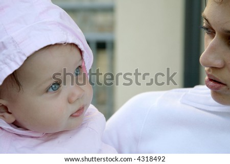 cute blue-eyed baby girl with mother