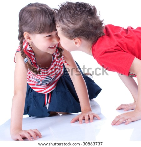 Cute blue-eyed boy and girl are playing , stidio shot - stock photo
