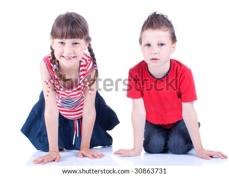 Cute blue-eyed boy and girl posing in the studio, isolated on white background - stock photo