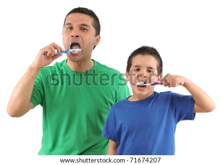 Cute boy and his father brushing teeth isolated on white background - SEE MORE RELATED IMAGES. - stock photo