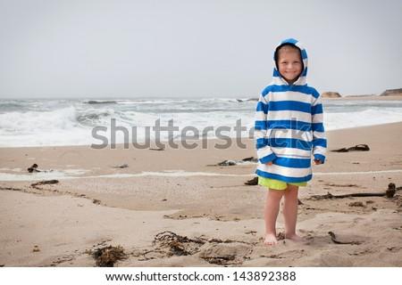 Cute boy at a California State beach - stock photo