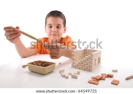 Cute boy building house isolated on white - a series of BUILDING A HOUSE  images. - stock photo