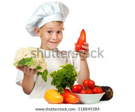 cute boy Chef with cauliflower and bell pepper