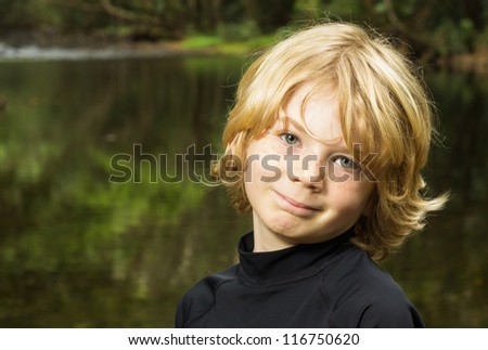 Cute boy child outside at the creak
