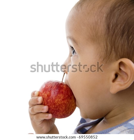 cute boy eating an apple, isolated on white background - stock photo