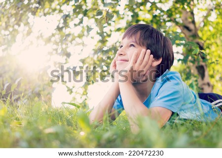 Cute boy enjoying in nature and posing for photography