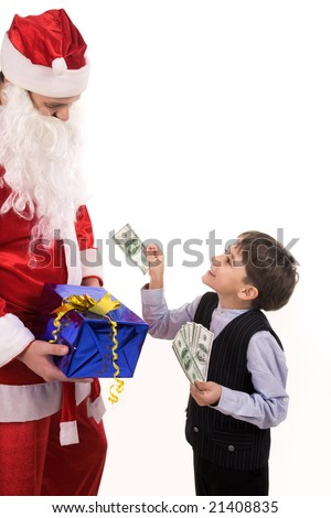 Cute boy giving dollar banknote to Santa and smiling at him - stock photo