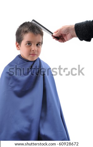 Cute boy having haircut  isolated on white background. - stock photo
