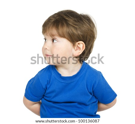 Cute boy hiding something behind itself. Isolated on white.