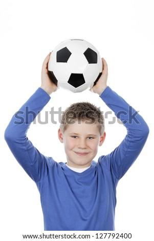 Cute boy holding a football ball - stock photo