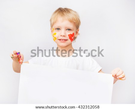 Cute boy holding blank white poster in hands isolated on white background. Beautiful baby face with red heart and yellow sun on cheeks. Happy childhood. Advertising concept. - stock photo