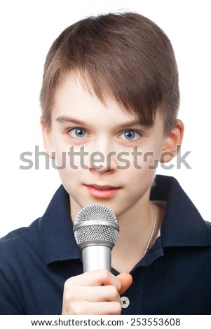 Cute boy holding microphone on white background - stock photo