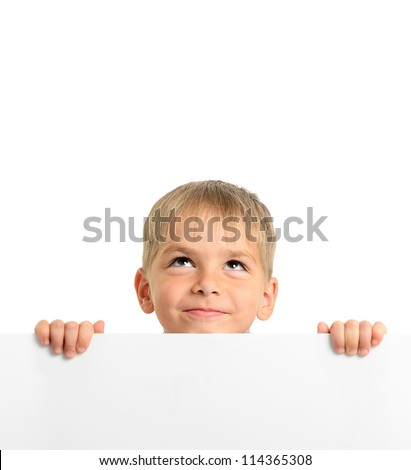 Cute boy holding white board and looking up, isolated on white - stock photo