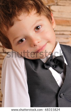 cute boy in a suit and bow tie