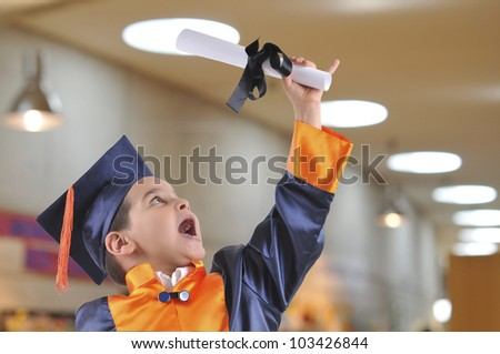 Cute boy in graduation uniform - stock photo
